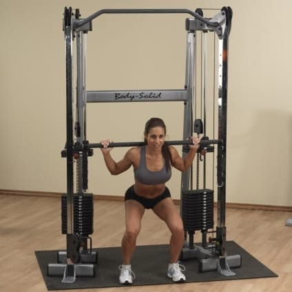 Woman using the weight stack on the GDCC210 By Body Solid
