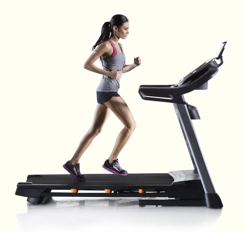 Woman Running On The Top Rated NordicTrack C16450 Treadmill